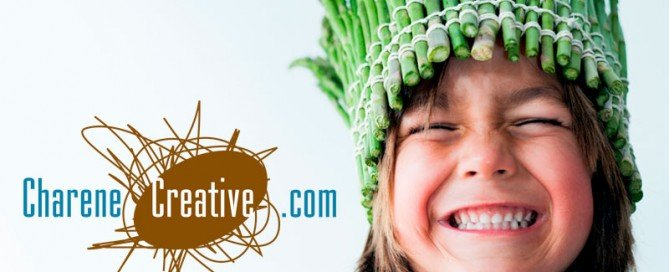 This is a cute picture of a little girl with an asparagus crown and huge smile. Next to here is the Charene Creative logo.